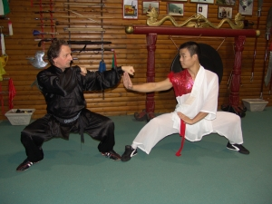 GM Walter Toch with shaolin monk and workshop sanda fighting in his Academy.